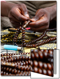 A Man Makes Muslim Rosaries in Treichville in Abidjan