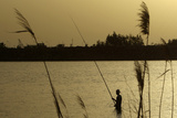A Libyan Man Fishes in the Sea of Benghazi