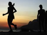 A Brazilian Woman Runs During Sunset Near Arpoador Beach in Rio De Janeiro