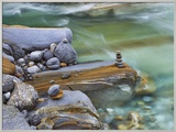 Small stone cairn on striated boulder in the Verzasca River