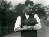 Keeper Harry Warwick Cradles a Baby Warthog in His Arms at London Zoo  August 1922