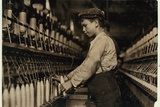 A Doffer Replaces Full Bobbins at Globe Cotton Mill  Augusta  Georgia  1909