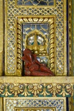Hinduism: Small Reclining Ganesha (Elephant-Headed Deity) Statue on Ornate Gilded and Mirrored Wall