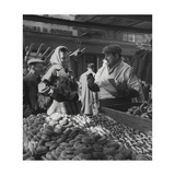 Woman with a Small Terrier Buying Bagels at a Market Stall  Possibly London  C1945-50