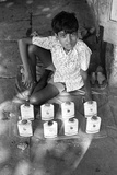 Boy on Pavement with Recycled Powder Cans  Mohammed Ali Road  Mumbai  India  1976