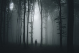 Spooky Halloween Scene with Man in Dark Forest