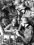 German Soldiers Using an Enigma Machine