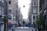A Man Bikes Down the Streets of Amsterdam  One of the Most Bike-Friendly Cities in the World
