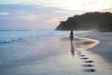 A Girl Walking Down a Tropical Beach in Costa Rica at Sunset