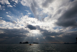 Andaman Sea: A Kayaker in the Andaman Sea under Rays of Light