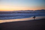 El Porto Beach  Los Angeles  California  USA: A Surfer Exits the Waves at Dusk
