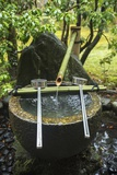 A Water Basin Carved from Stone with Bamboo Water Supply Pipe and Ladles  at Koinzan Saihoji