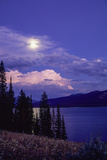 Landscape of Clouds over a Lake and Pine Trees