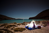 Sea of Cortez  Mexico: A Camper on the Beach with a Sailboat in the Background