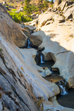 Sierra Nevada Mountains  California: Hiker Stands on Edge of a Waterfalls at the Seven Teacups