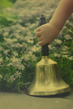 Child's Hand Holding Bell