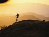 A Woman Runs on Red Rocks