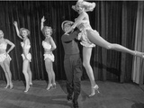Actor Clowning around with Dancing Girls During the Nightlife in Las Vegas
