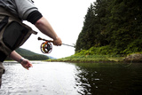 A Man Casts a Fly Rod over Shallow  Calm Waters of a Remote Inlet in Alaska