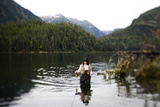 A Woman  Using a Fly Rod  Fishes for Spawning Salmon