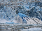 A Huge Piece of Ice  a Shooter  Surfaces after Underwater Glacier Calving