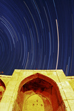 A Time-Exposure of Star Trails Above a Historic Caravansary the Brightest Trail Is Planet Mars