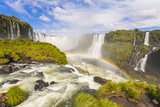 A Rainbow at Iguazu Waterfalls on the Border of Argentina and Brazil in South America