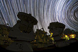 A Time-Exposure Image of Star Trails over the Alma Radio Telescopes  5000 Meters High in the Andes