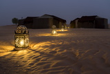 Lanterns Illuminate a Path Toward Tents in the Erg Chebbi Sand Dunes