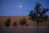 The Moon Sets Above the Erg Chebbi Sand Dunes in Southeastern Morocco