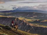 Wranglers on Horses Looking over the Dubois Badlands and Ramshorn Mountain  in Wind River Valley