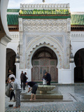 Men Performing Ablutions Prior to Prayer at the Karaouine Mosque Seen from Rue Boutouil  Fes