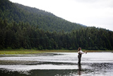 A Woman  Using a Fly Rod  Fishes for Salmon