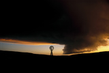 A Lone Sandhills Windmill Stands Strong in Silhouette as a Wall Cloud Looms on the Western Horizon