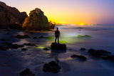 A Man Looks Toward the City Lights of Los Angeles from El Matador State Beach