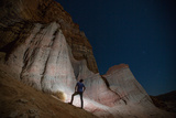 A Man Looks Up at Red Rocks in the Eastern Sierra Nevada Mountains