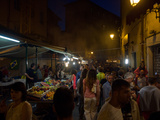 Crowd in Front of Fruit Stands in Street at Night  Via Cavalca  Pisa  Tuscany  Italy