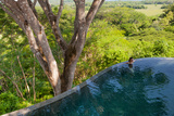 A Girl Sits in an Infinity Pool in Costa Rica