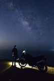 A Motorcyclist Looks Up at the Milky Way