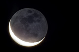 Telescopic View of Crescent Moon and Earthshine  the Night Side of the Moon Illuminated by Earth