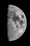 The Moon Seen Through a Telescope with the Lunar Terminator  or Day-Night Line