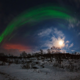 View of the Aurora Borealis  Northern Lights  Moon  and Scattered Light Pollution