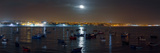 The Moon Rises Above Boats in the Bay of Cascais  Portugal