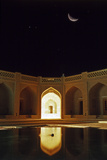 A Double-Exposure  Composite  of the First Quarter Moon over the Historic Caravansary of Khoranaq