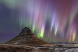 Strong and Colorful Aurora Borealis in the Foreground Is Iconic Kirkjufell Volcano