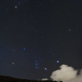 The Starry Sky with a Passing Cloud Next to Constellation Orion and Comet Lovejoy