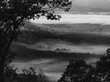 Morning Fog Swirls in the Valley Below on an Autumn Morning in This Black and White View
