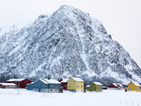 Colorful Houses in Front of a Mountain in Winter