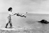 Jackie Kennedy and Daughter Caroline Playing on the Beach July 22  1963