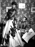 Fashion Designer Oleg Cassini Showing His Drawings to Gene Tierney to Show Her the Clothes in 1941